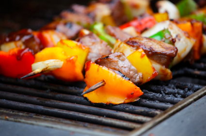 Kebabs on skewer cooking on a barbecue